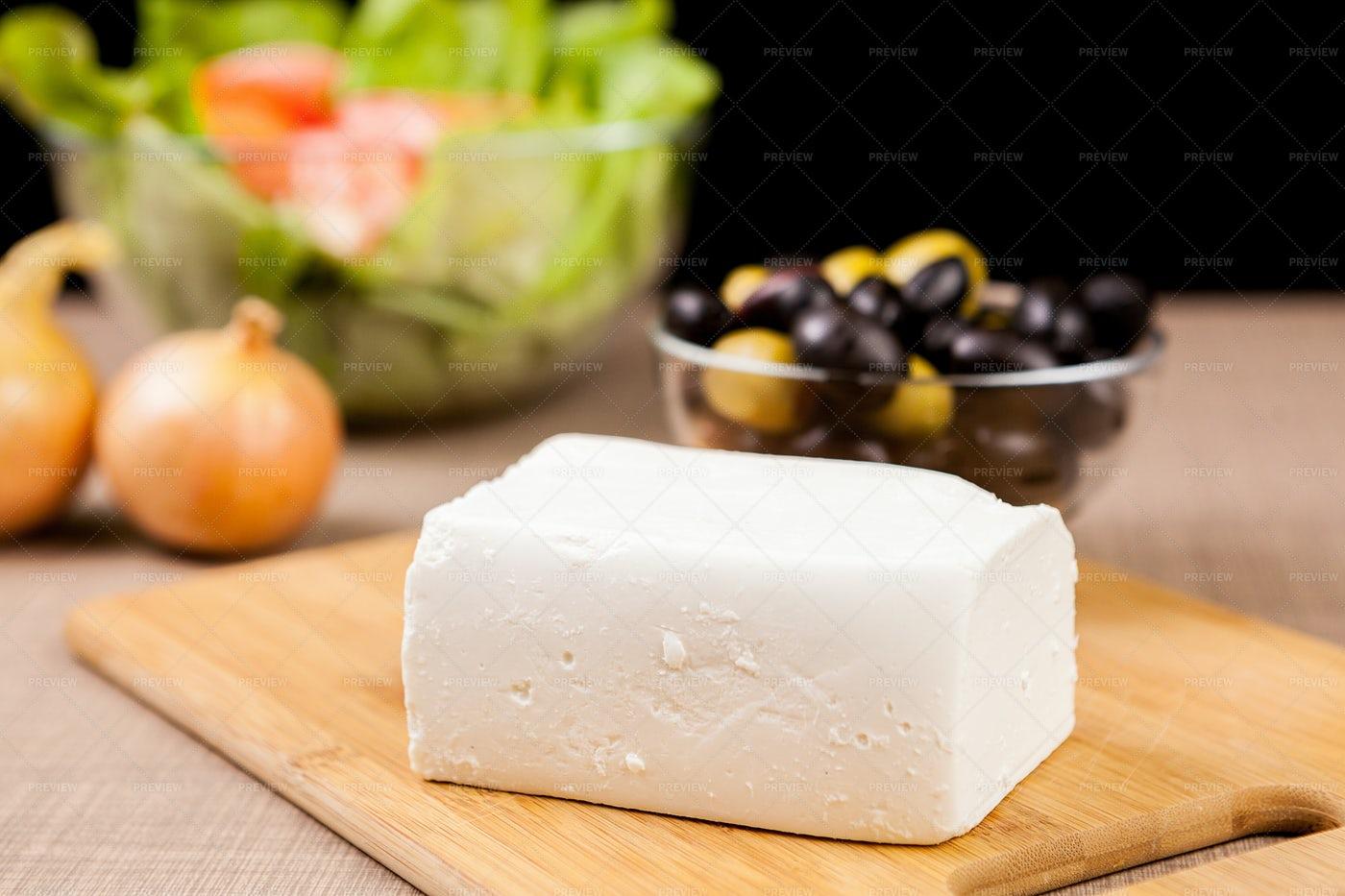 Feta Cheese On A Wooden Board: Stock Photos