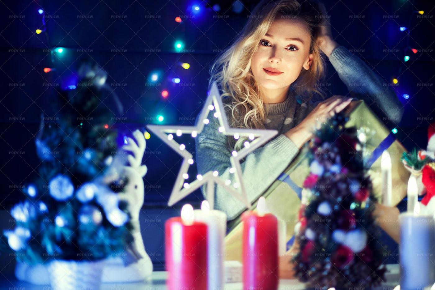 Happy Girl Next To Christmas Decoration: Stock Photos
