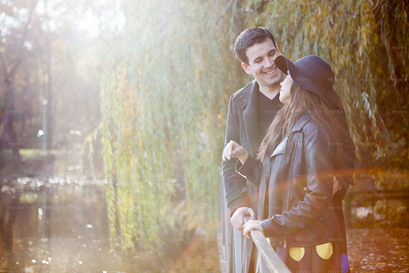 A Young Couple In The Park: Stock Photos