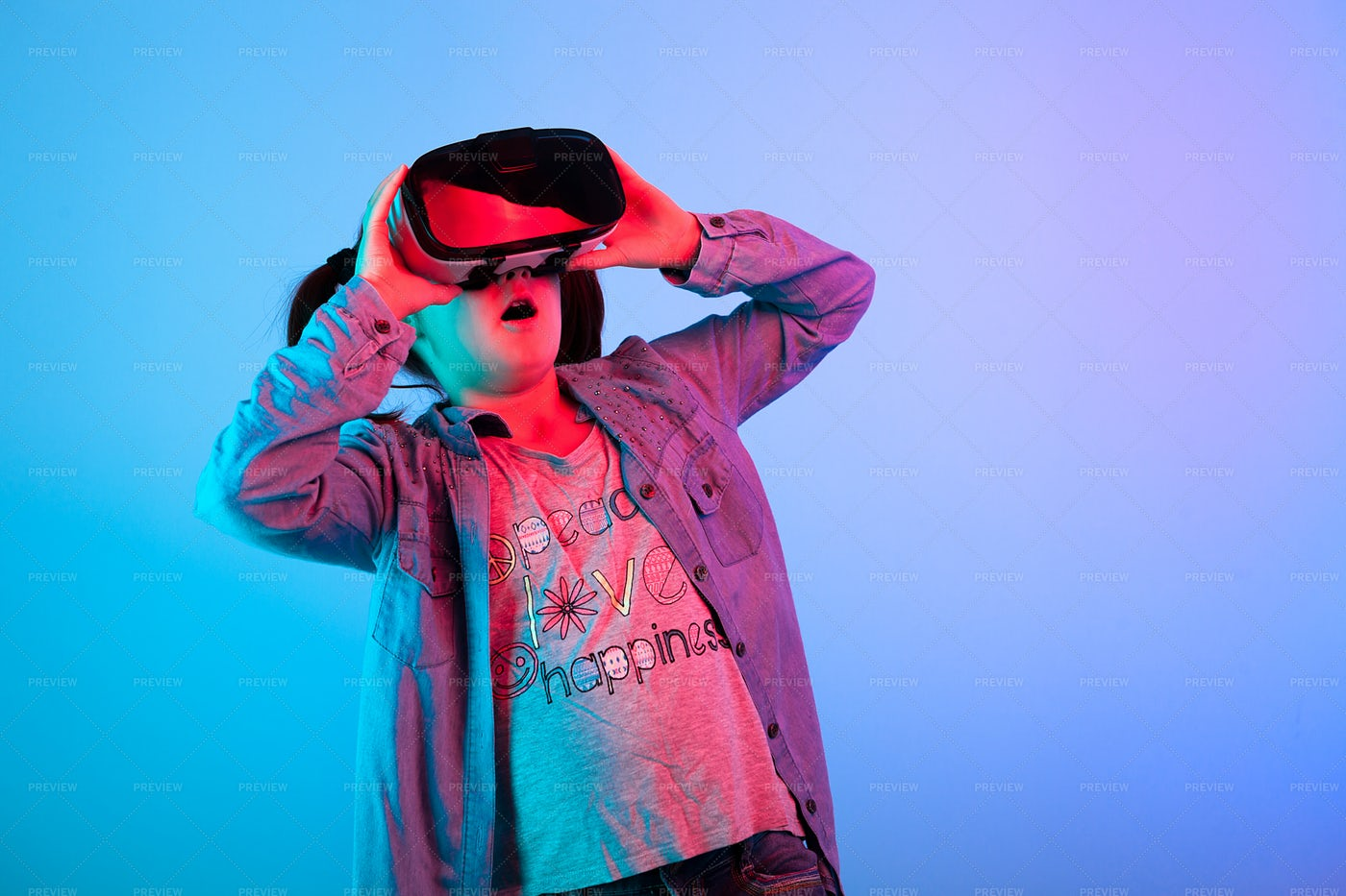 Surprised Girl Using A VR Headset: Stock Photos