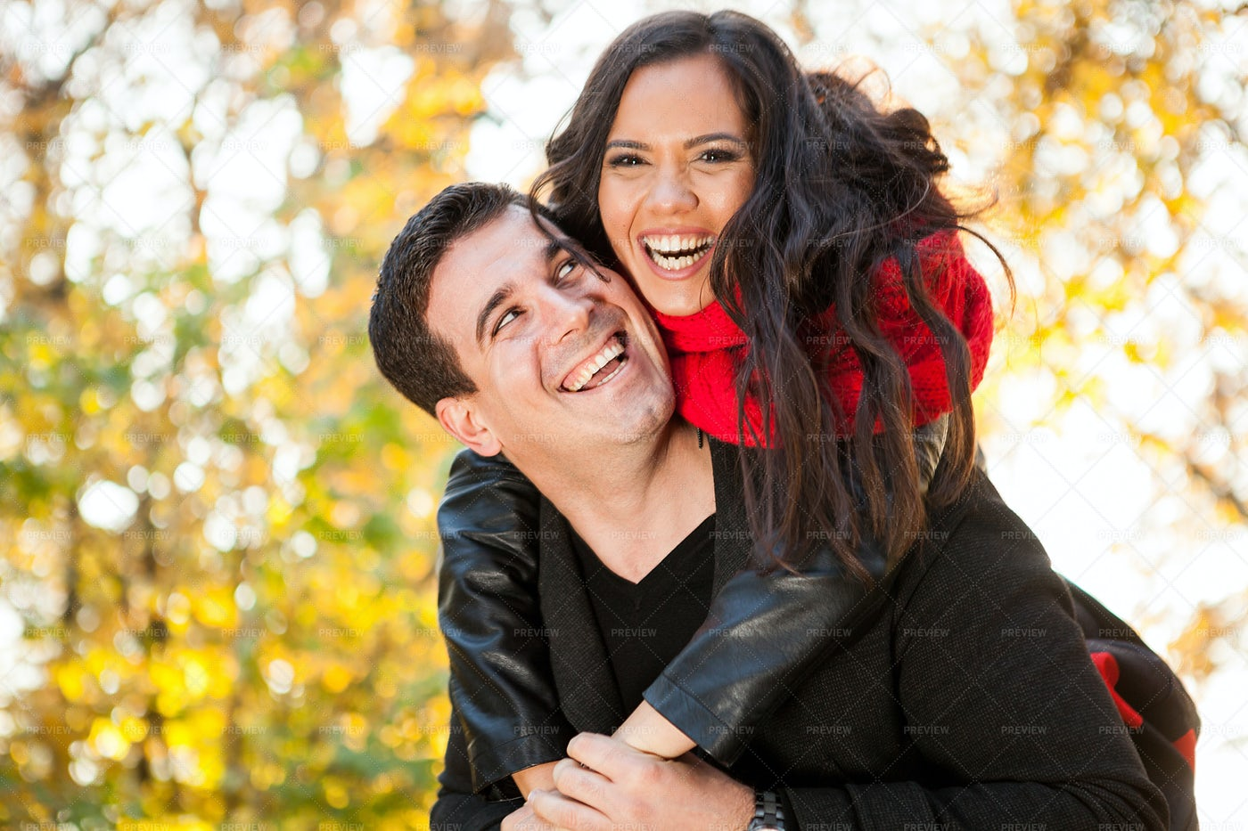 A Happy Couple In The Park: Stock Photos