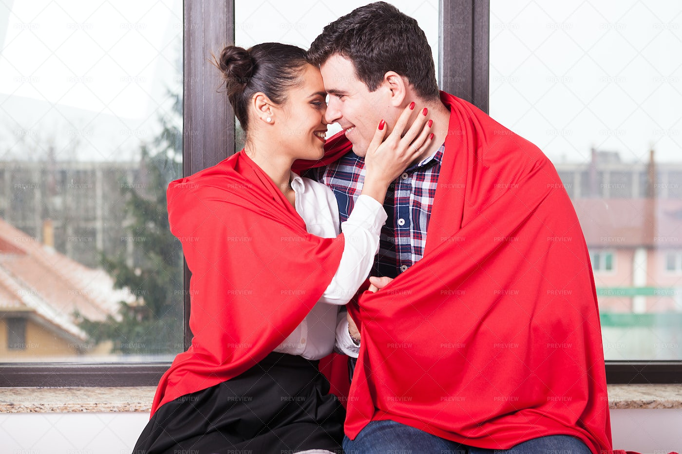 A Couple With A Red Blanket: Stock Photos