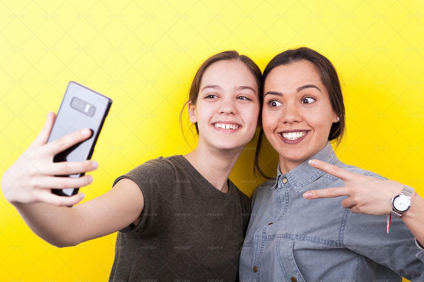 Sisters Taking Selfie: Stock Photos