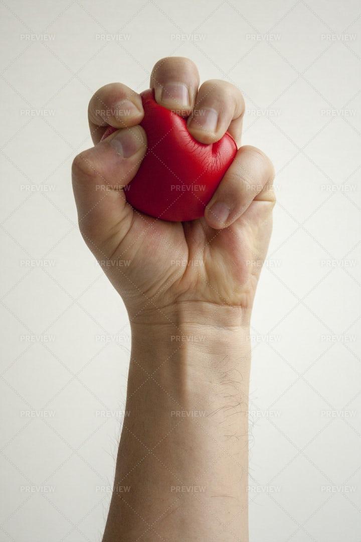 Squeezing A Rubber Heart: Stock Photos