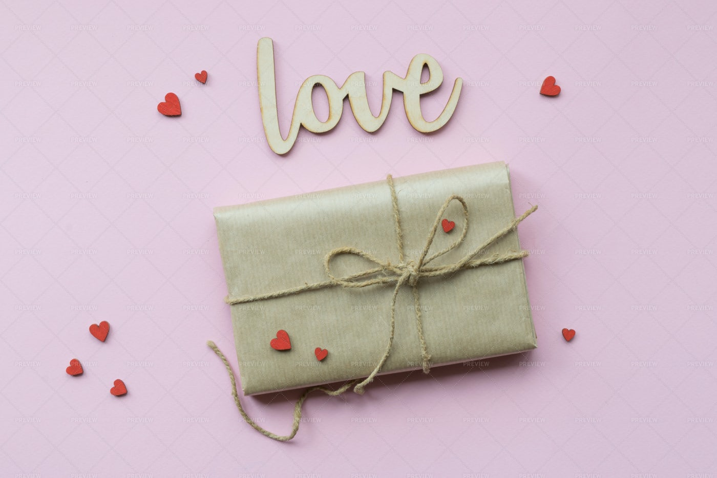 Romantic Gift With Decorative Red Hearts: Stock Photos