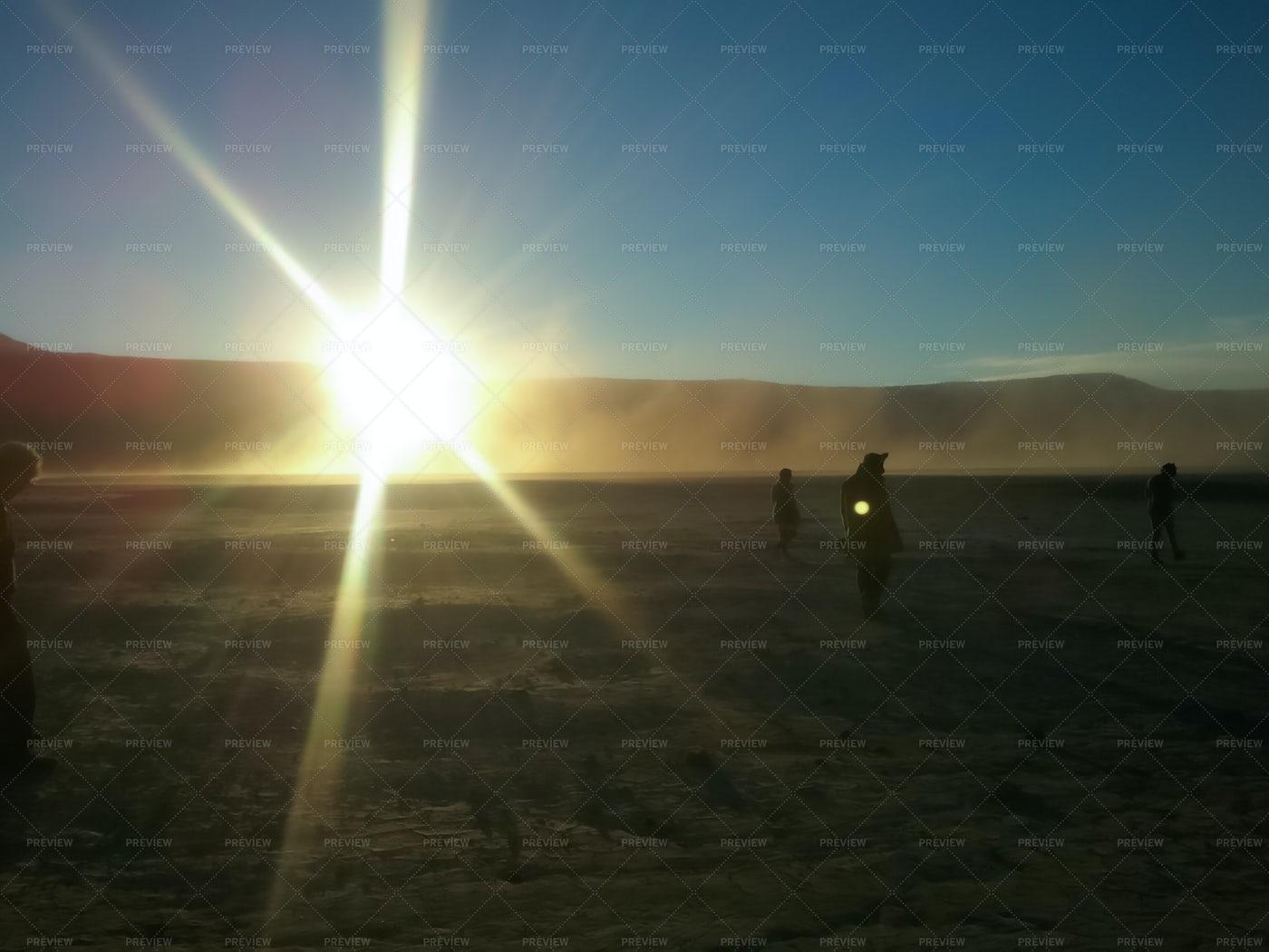 Desert Travelers With Sunrise: Stock Photos