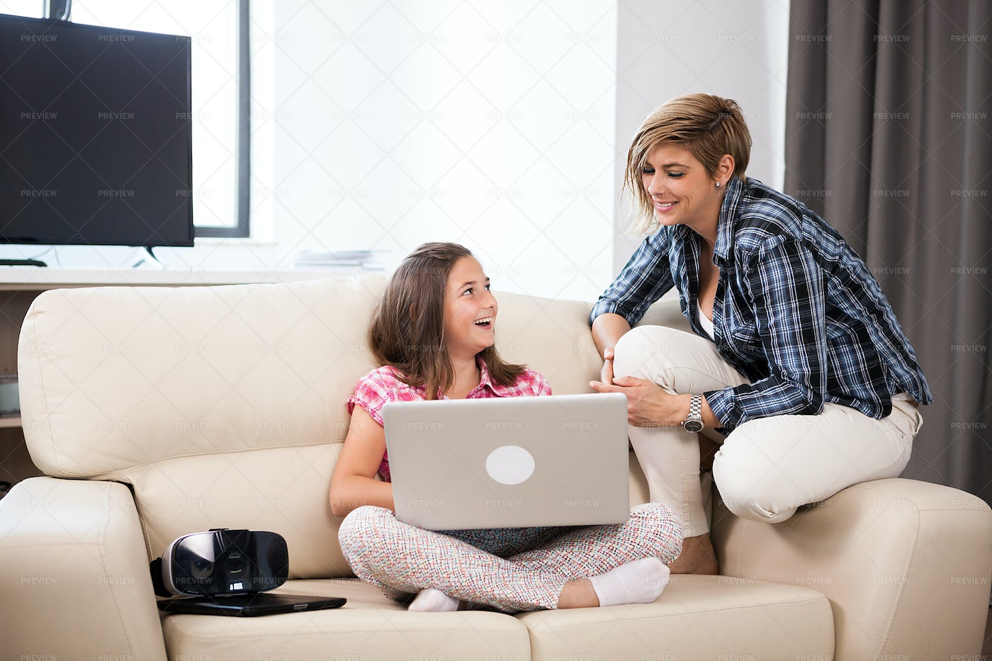 Girl And Mother With A Laptop: Stock Photos