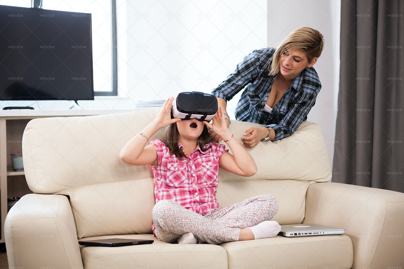 Daughter Wearing VR Goggles: Stock Photos