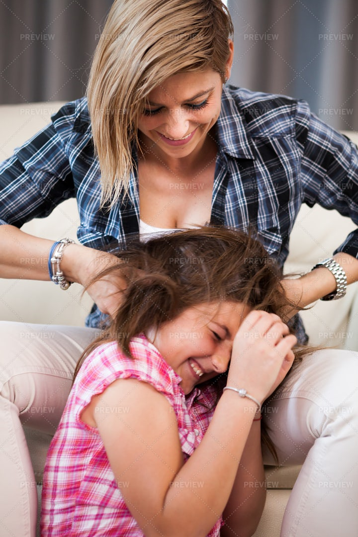 Mother And Daughter Laughing: Stock Photos