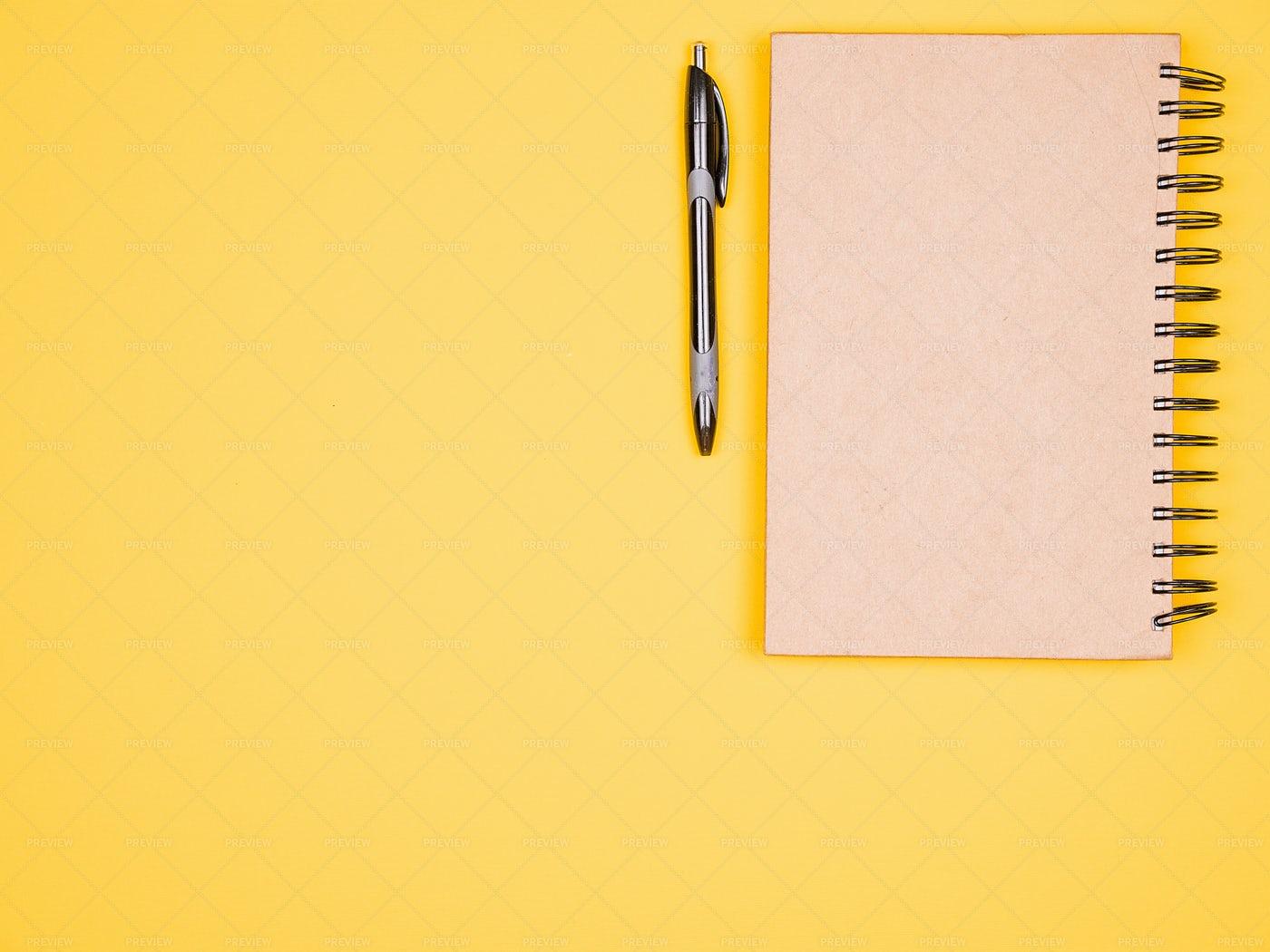 Paper Notebook Next To A Pen: Stock Photos
