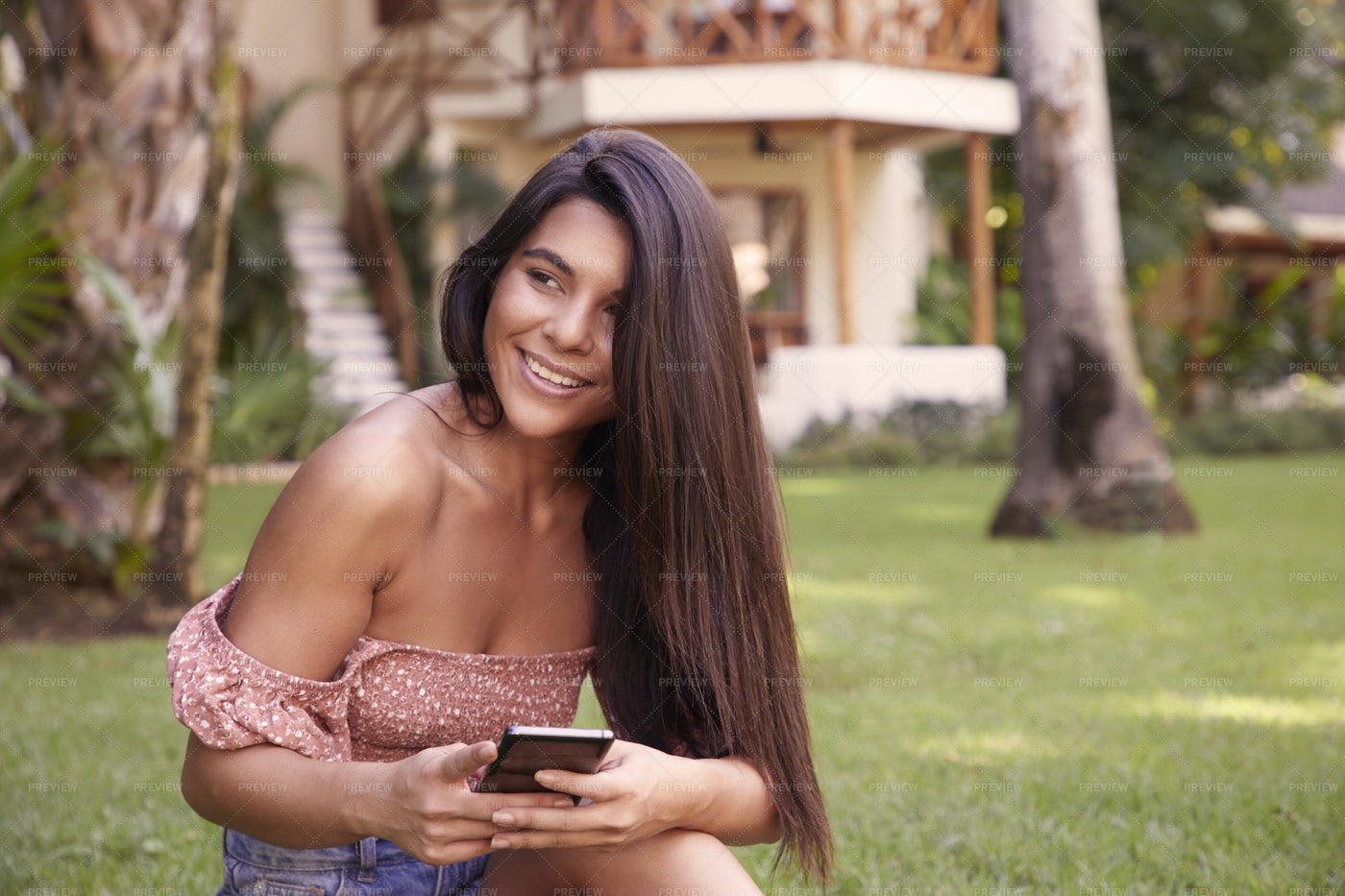 Smiling Girl On Smartphone: Stock Photos