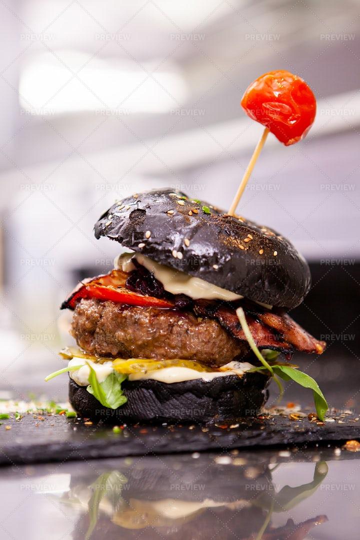 Black Burger On Stone Cutting Board: Stock Photos