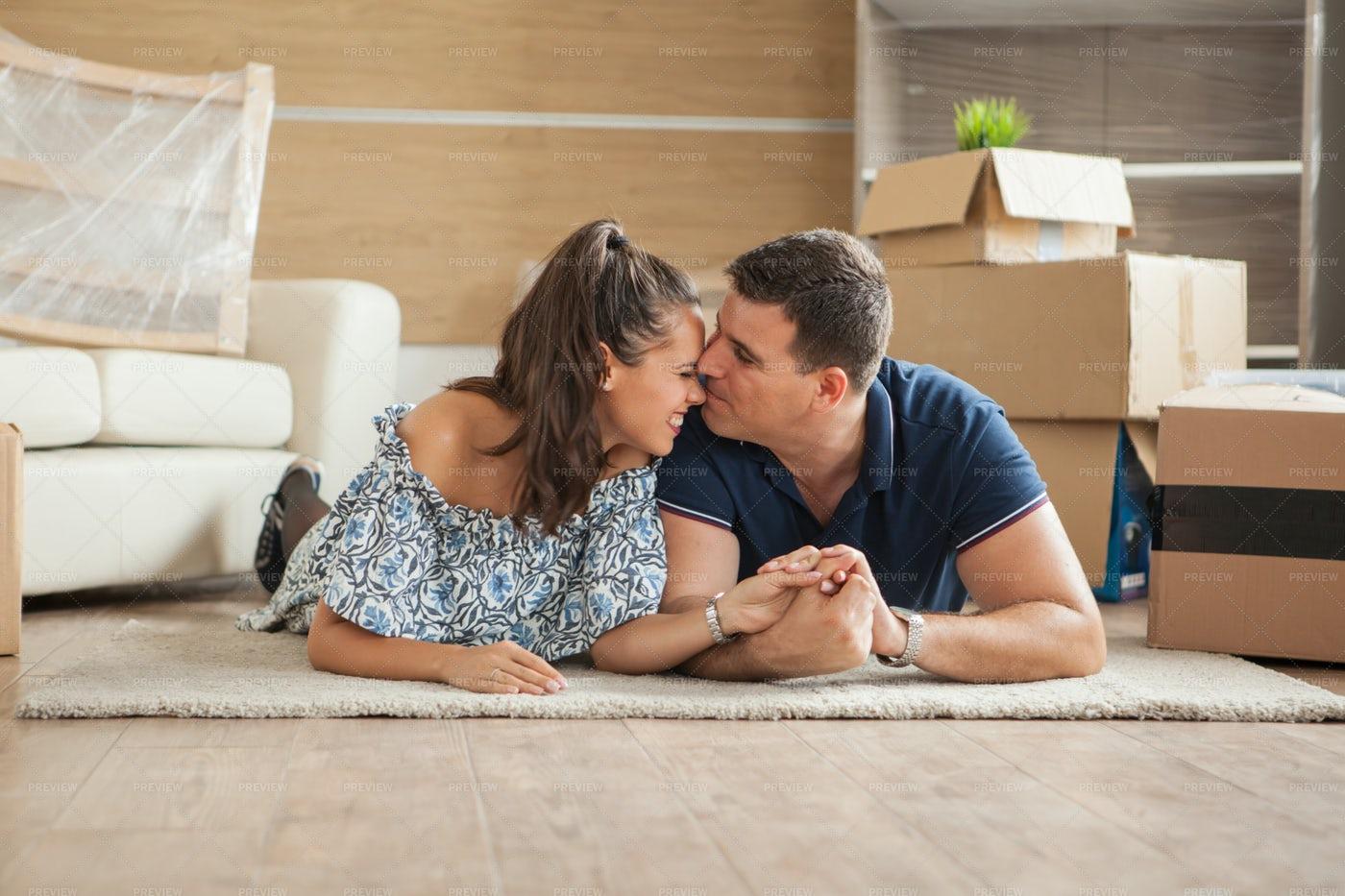 Couple Lying Happy On The Floor: Stock Photos