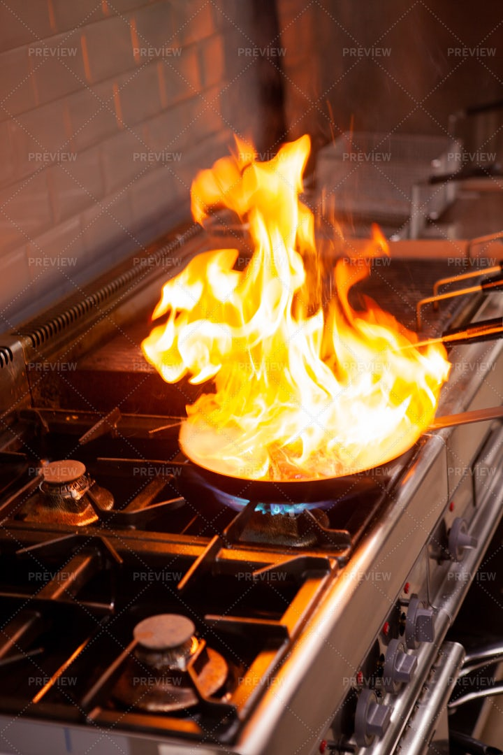 Chef Cooking With High Fire: Stock Photos