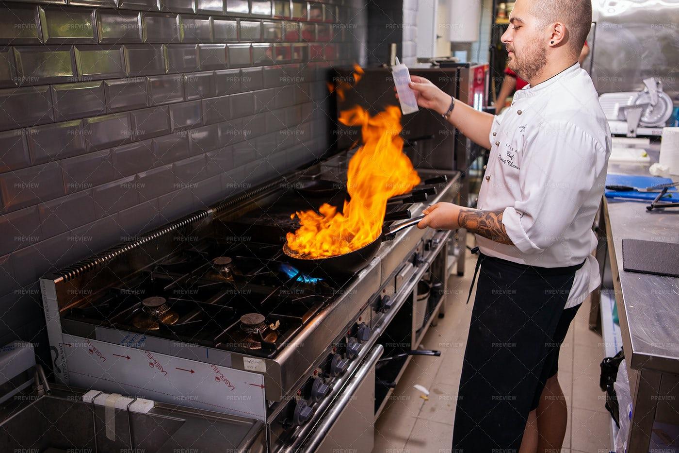 Chef Making Flambe At Stove: Stock Photos