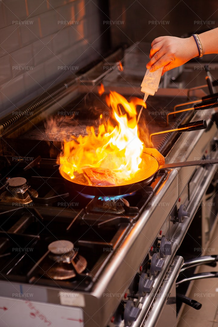 Cooking With High Fire In Kitchen: Stock Photos