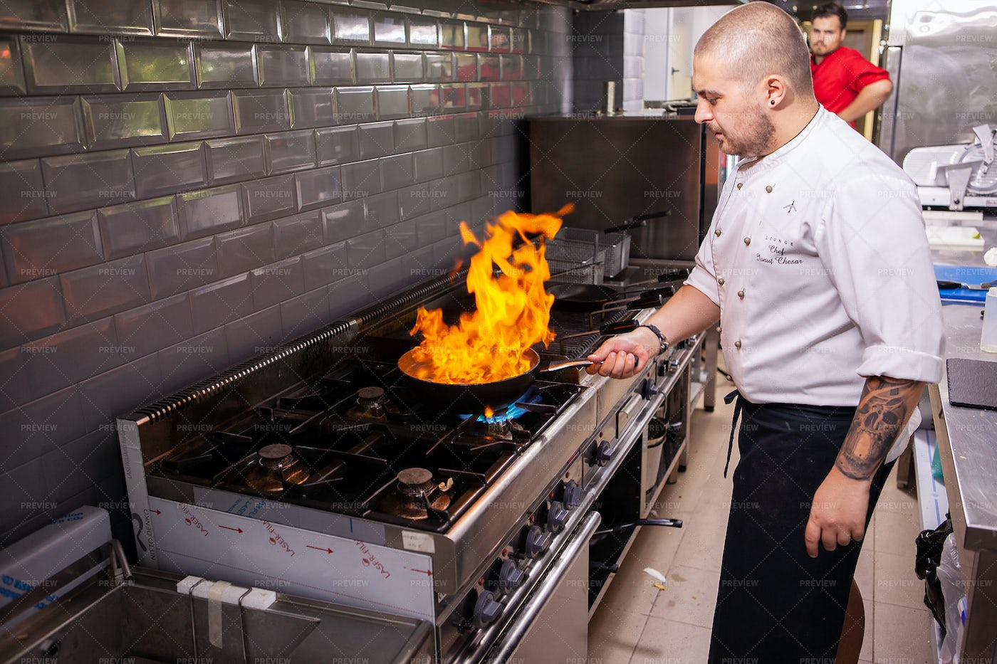 Chef Making Flambe In Kitchen: Stock Photos