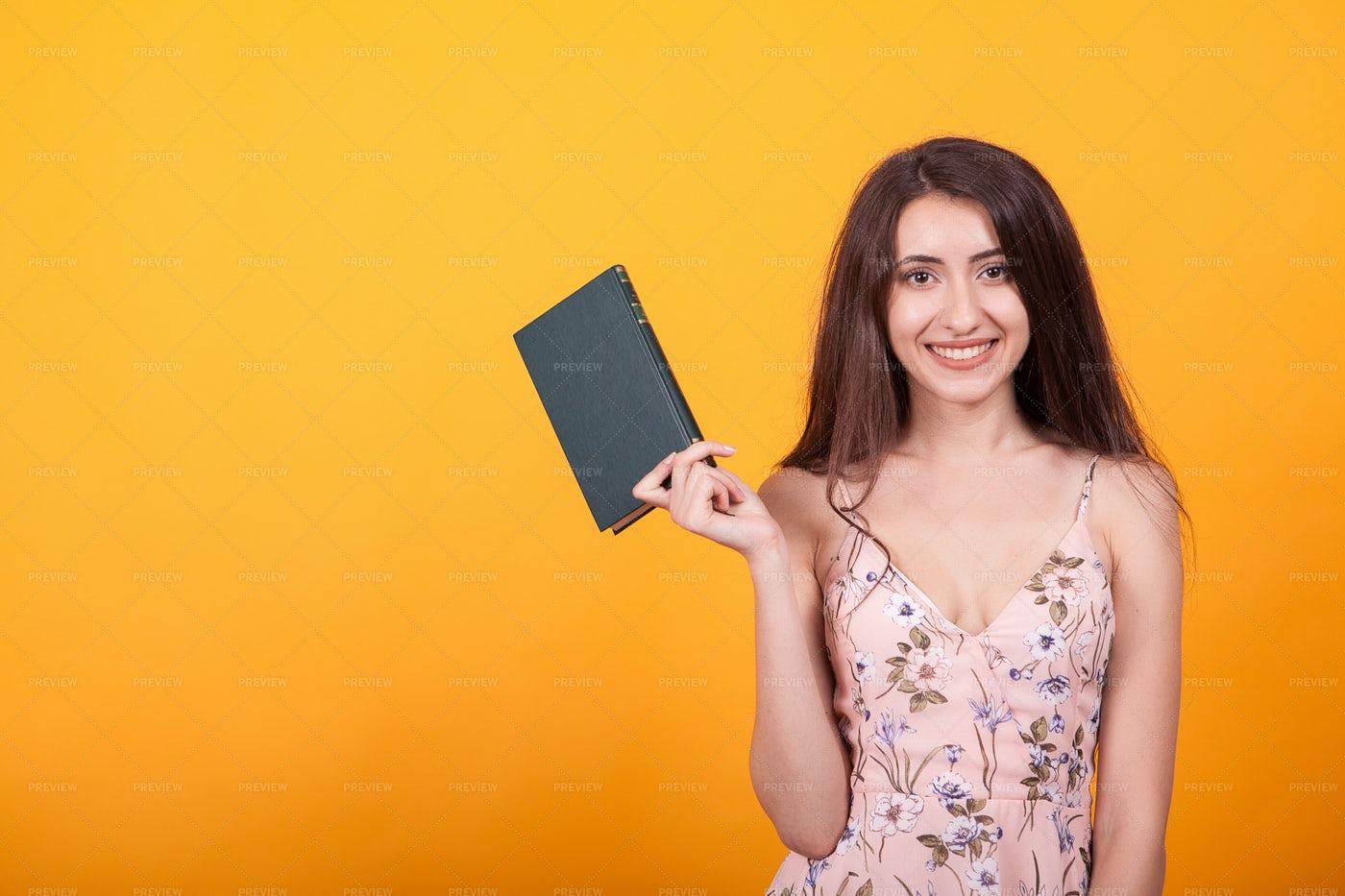 Girl Holding A Book: Stock Photos