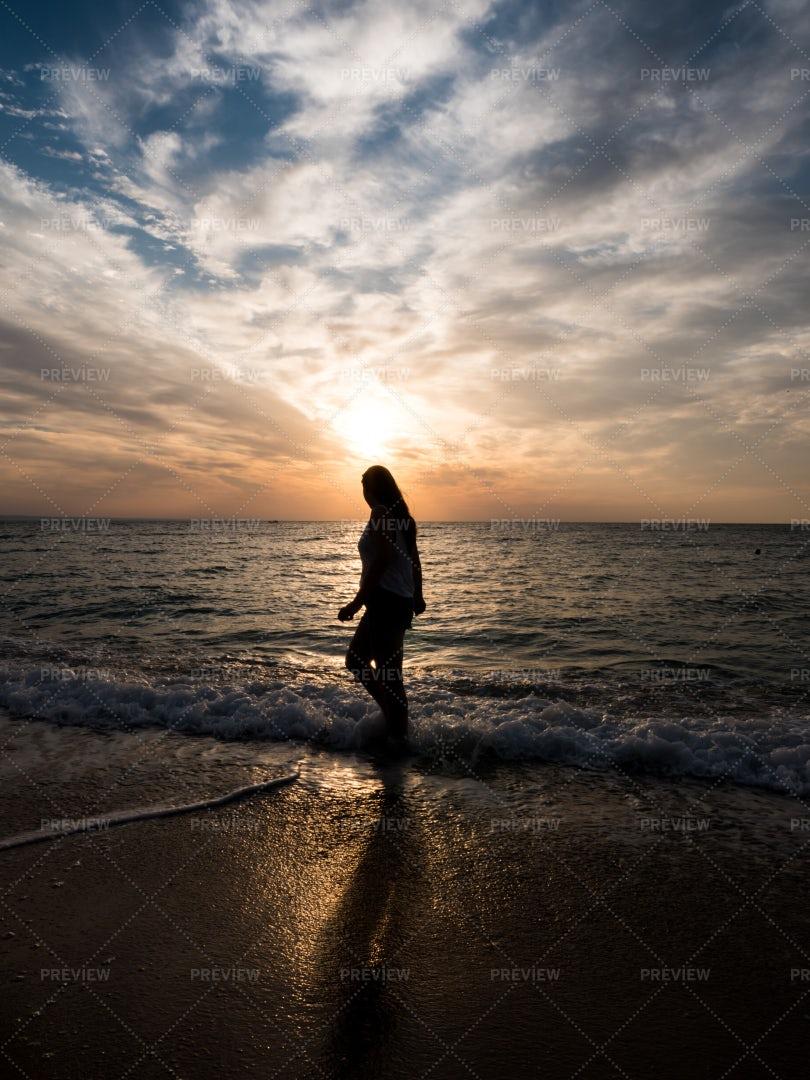 Walking On The Beach On Sunset: Stock Photos