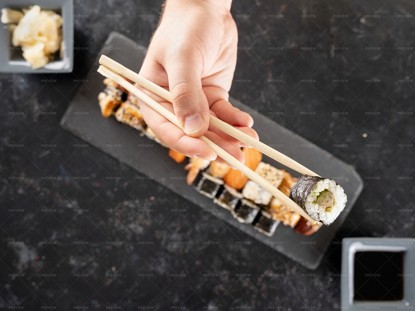 Picking A Sushi Roll: Stock Photos