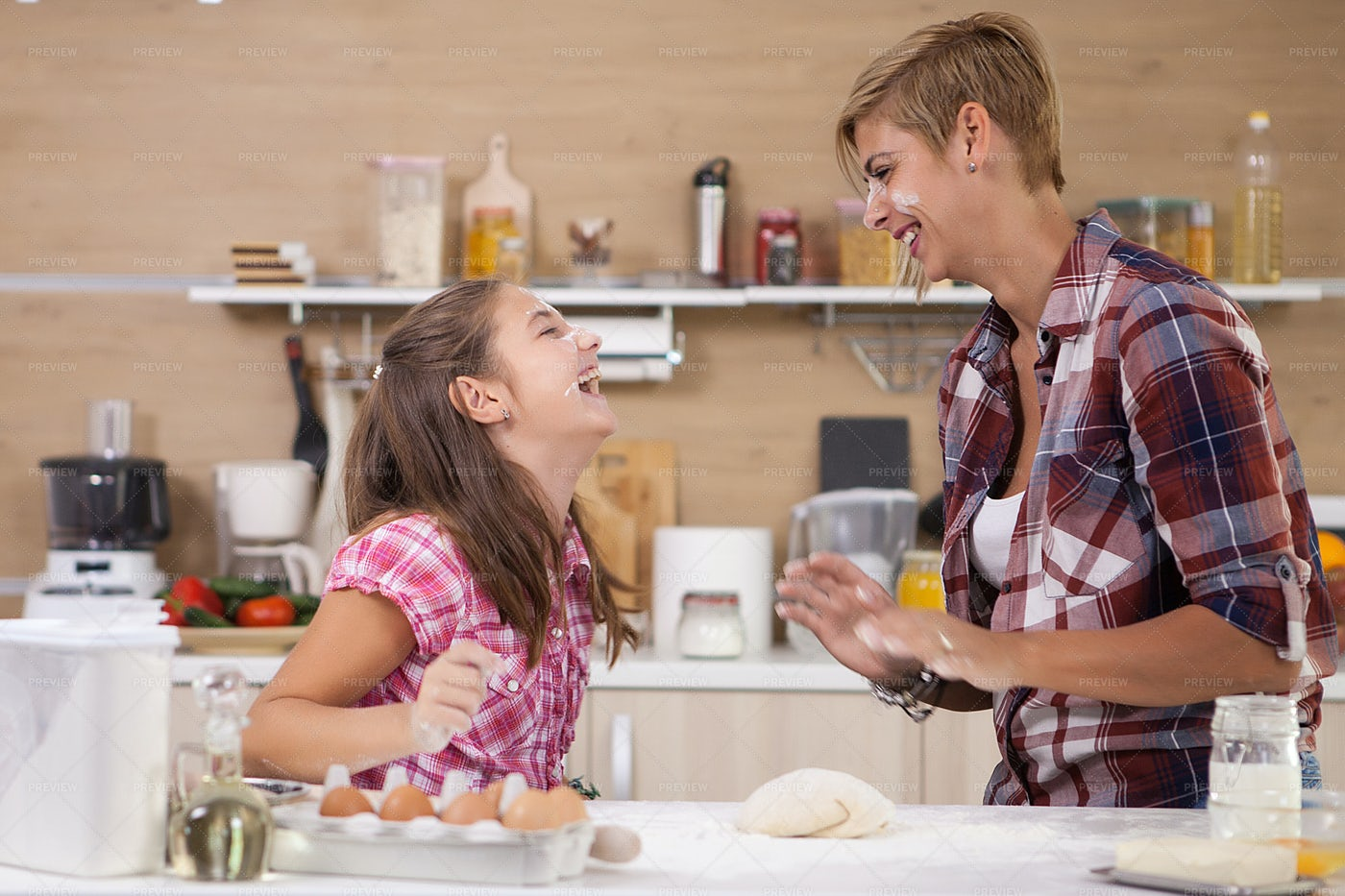 Girl Cooking With Her Mother: Stock Photos