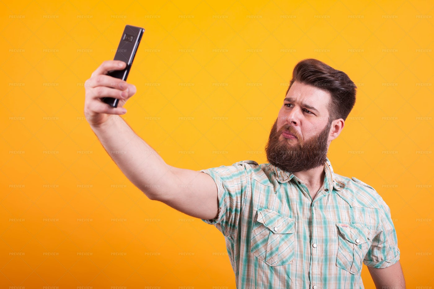 Man In Plaid Takes Selfie: Stock Photos