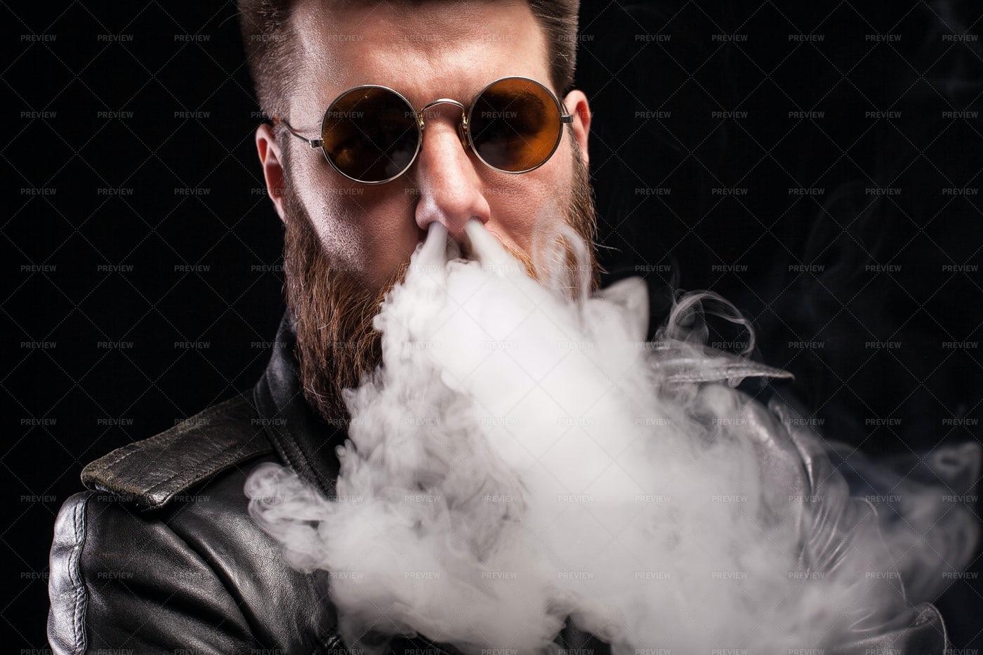 Exhaling Cigarette Smoke: Stock Photos
