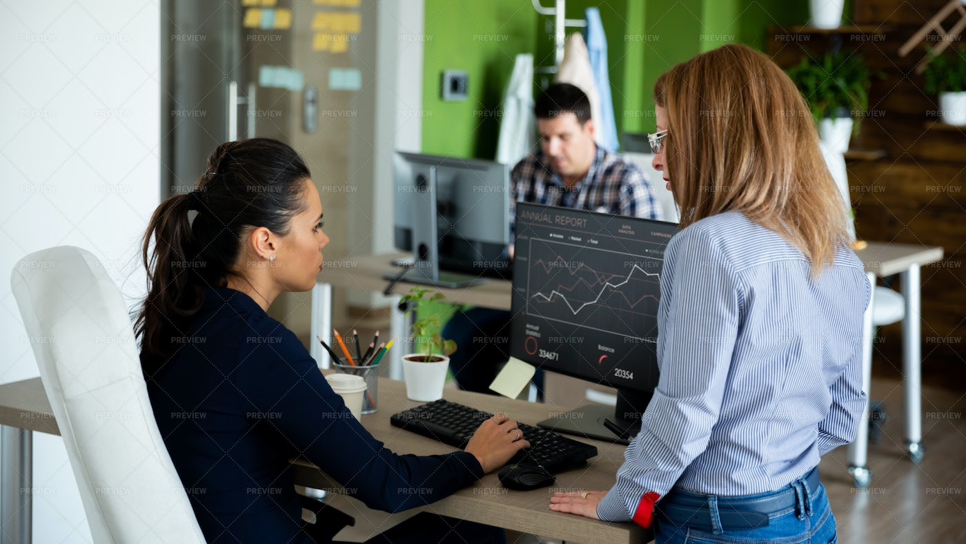 Two Businesswomen Discussing Graphs: Stock Photos