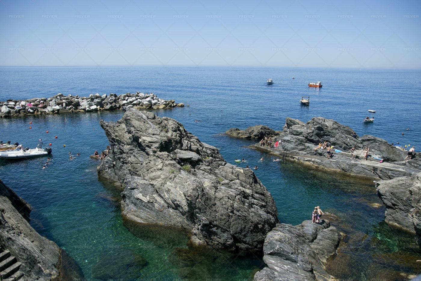 Playing On Rocky Italian Coast: Stock Photos