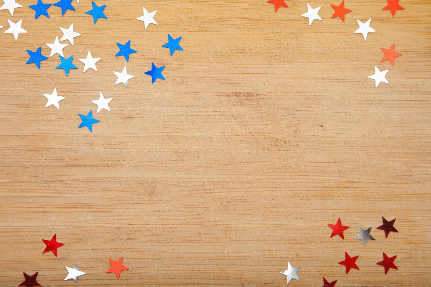 Confetti Stars On Wooden Background: Stock Photos