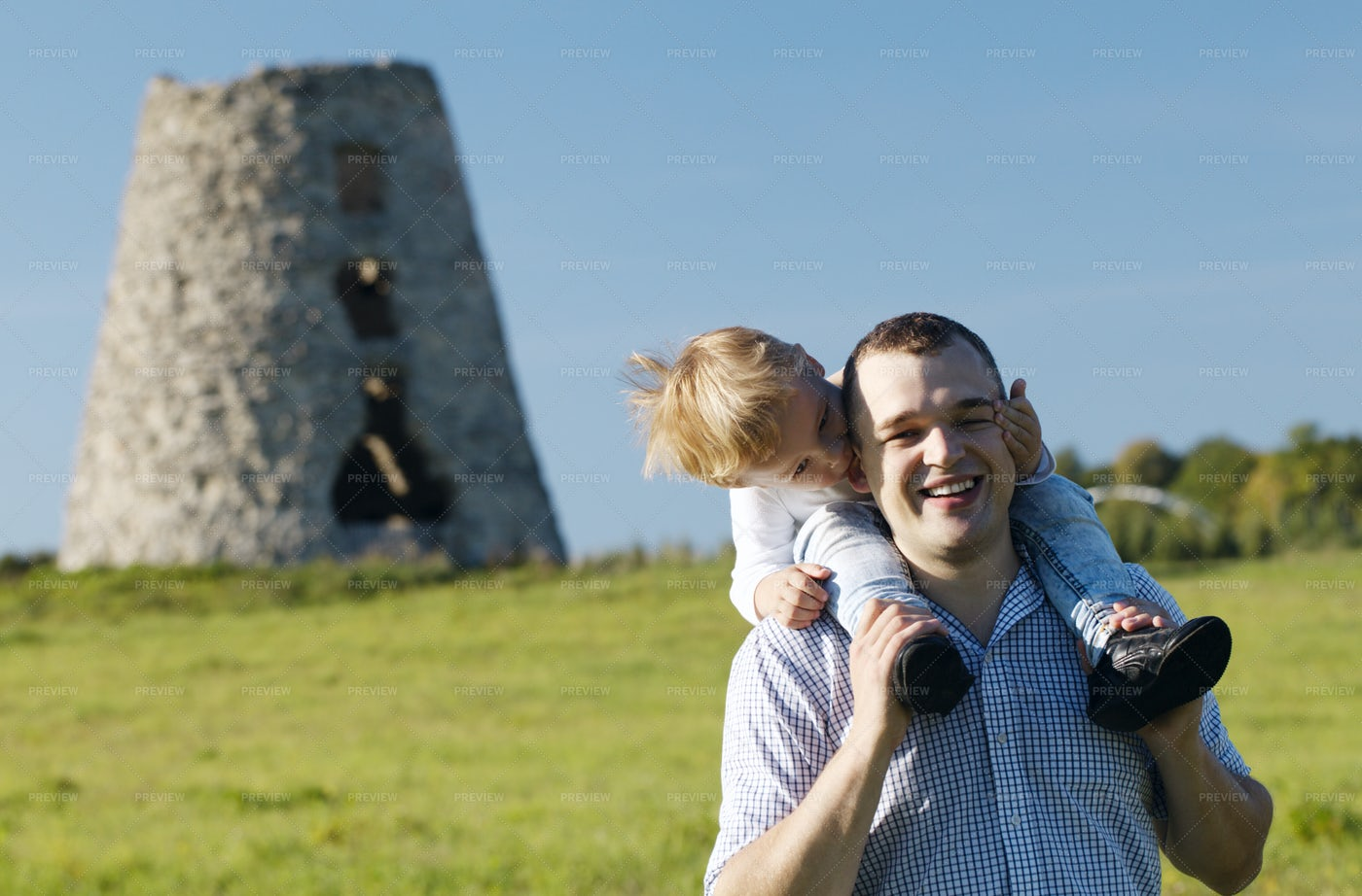 Happy Young Father And Son: Stock Photos
