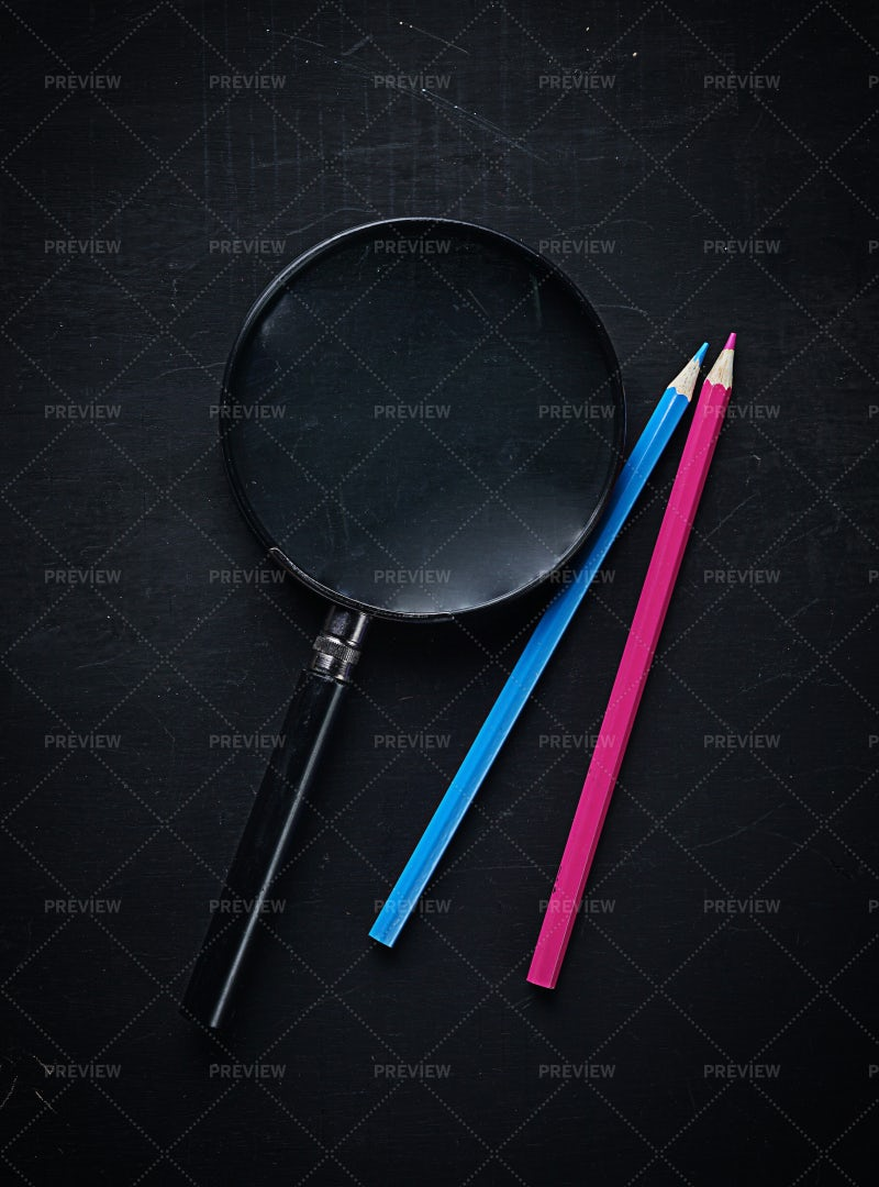 Magnifying Glass And Color Pencils: Stock Photos
