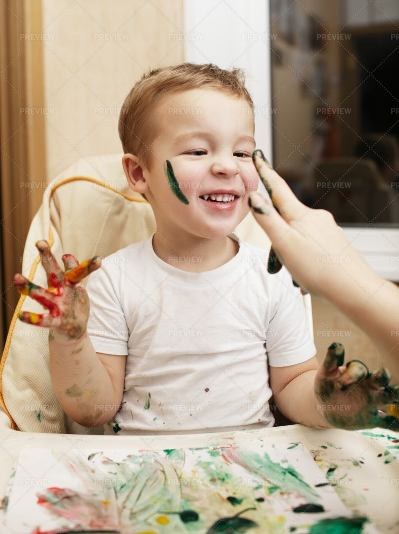 Messy Boy Finger Painting: Stock Photos