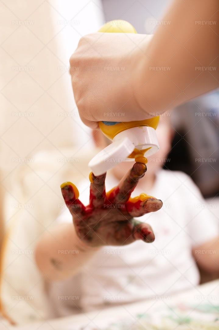 Applying Finger Paint: Stock Photos