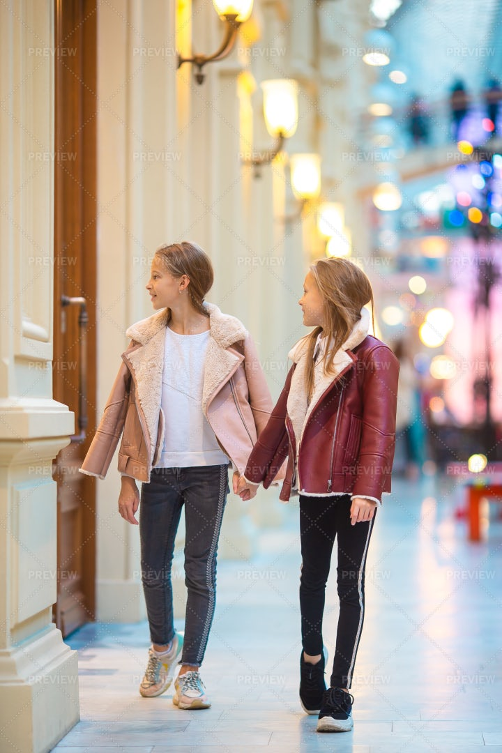 Walking Hand In Hand In Mall: Stock Photos