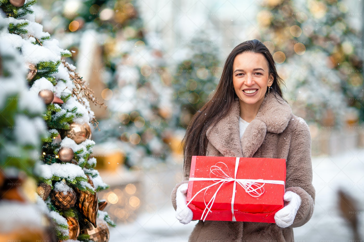 Christmas Present By The Tree: Stock Photos