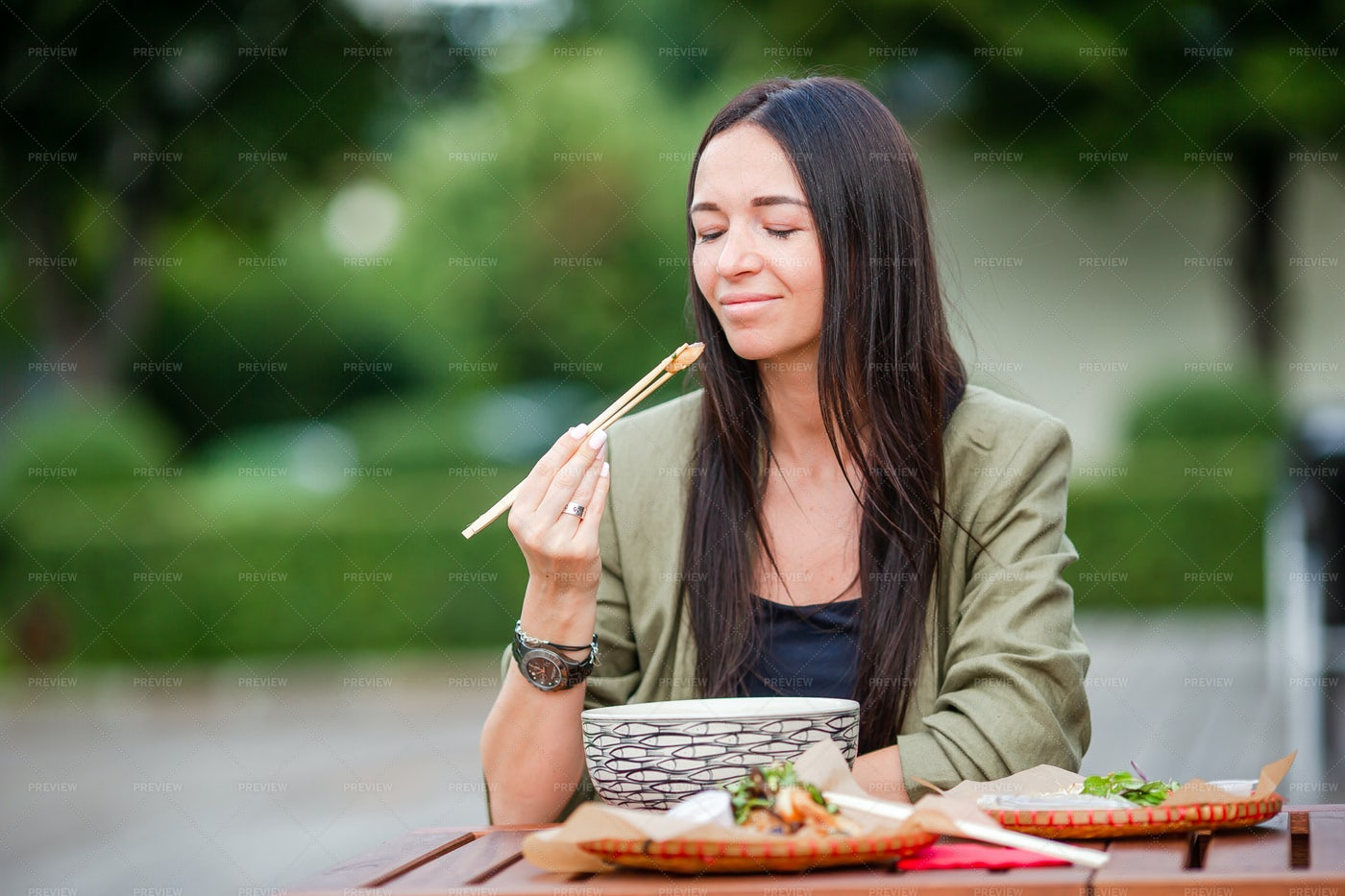 Woman Eating Vietnamese Dishes: Stock Photos