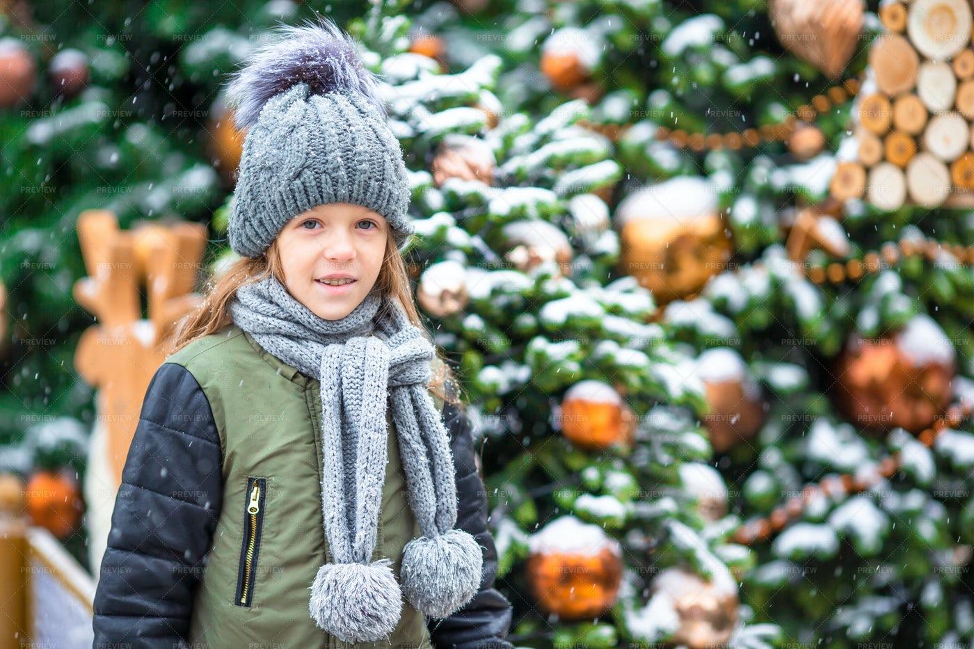 Girl Near Snowy Christmas Trees: Stock Photos