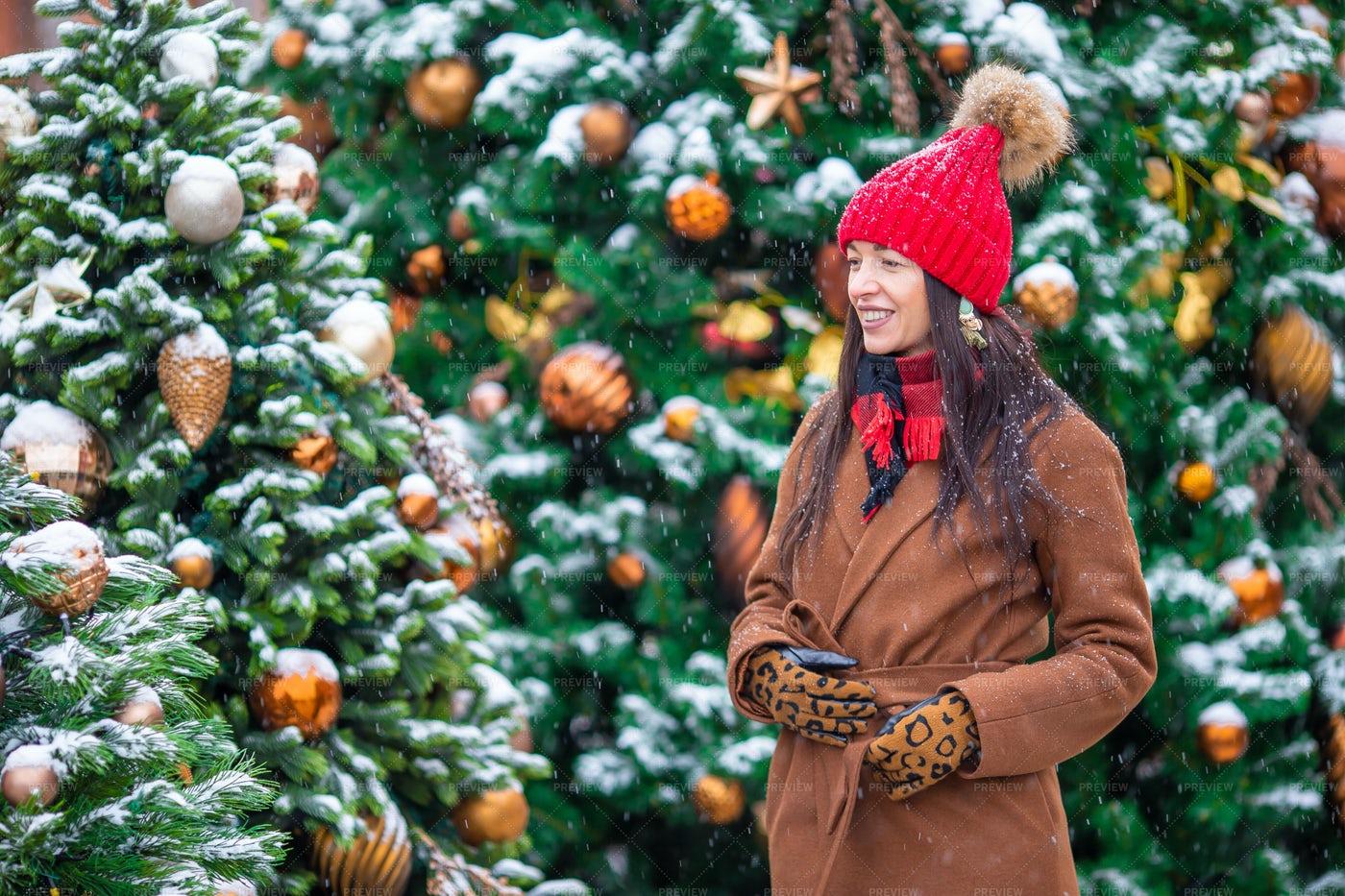 Woman Among Christmas Trees: Stock Photos