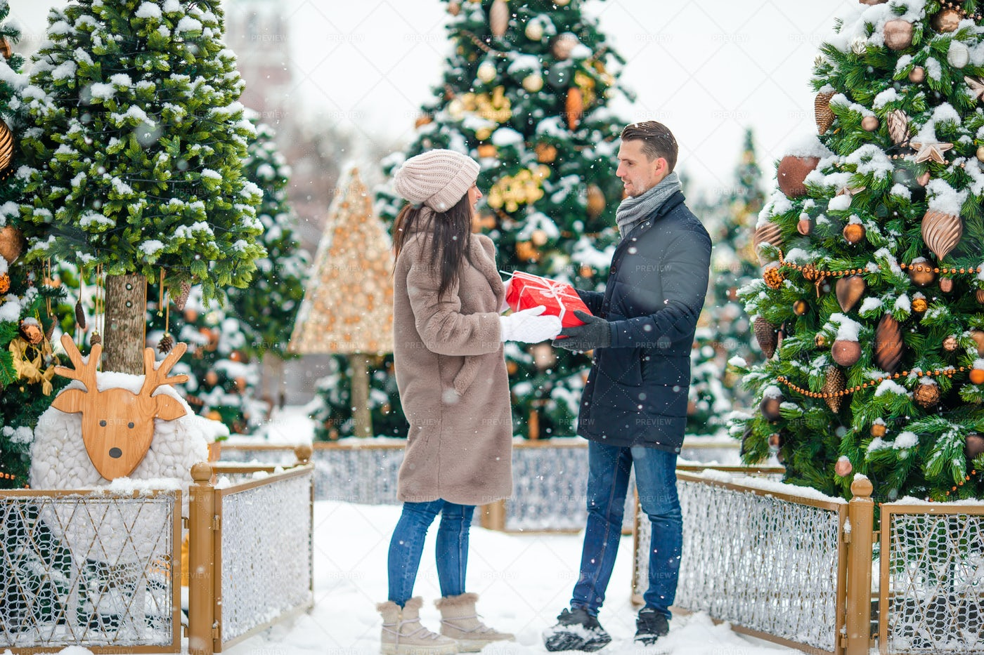 Couple With Christmas Gift: Stock Photos
