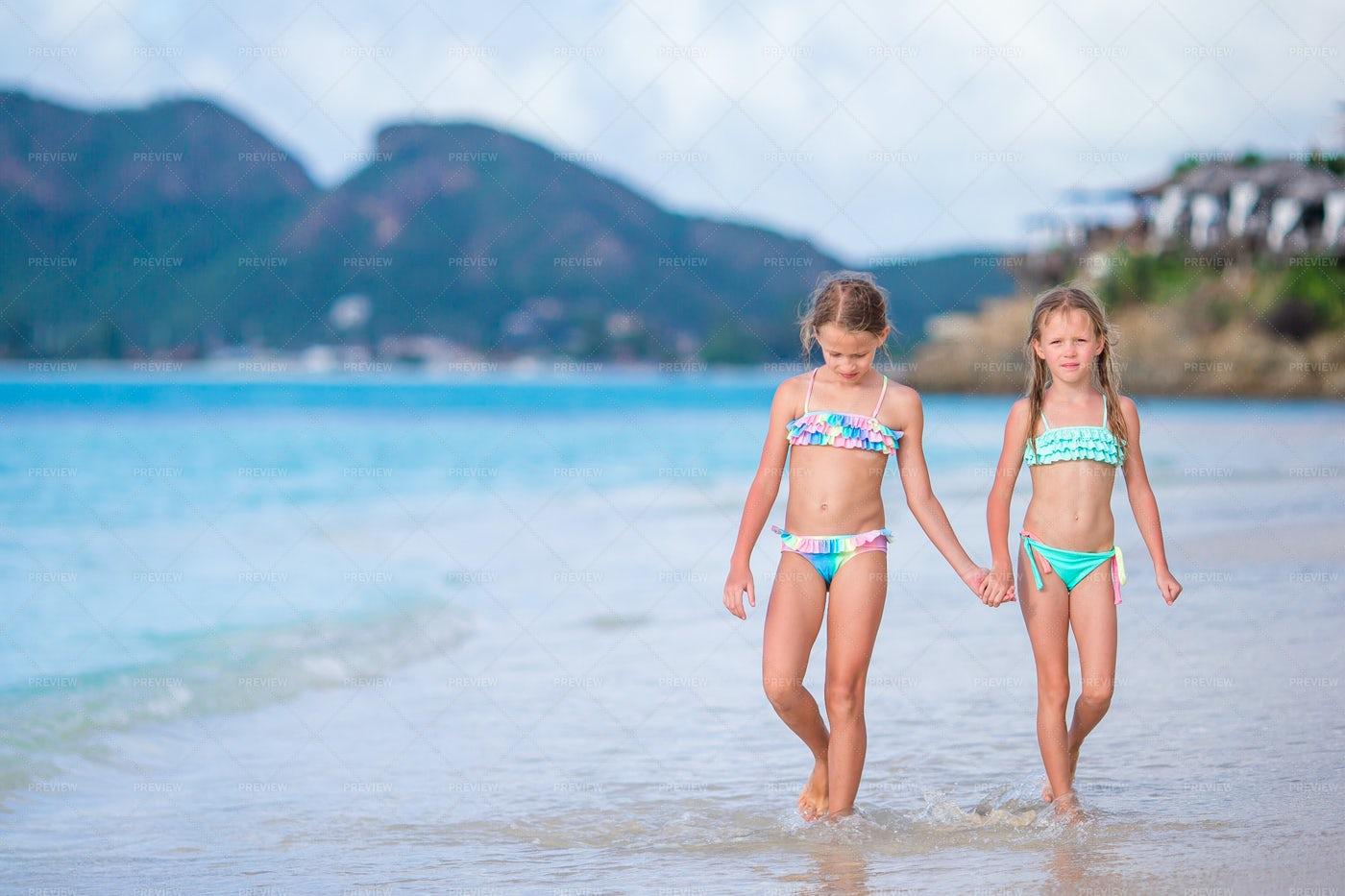 Sisters Walking At The Beach: Stock Photos