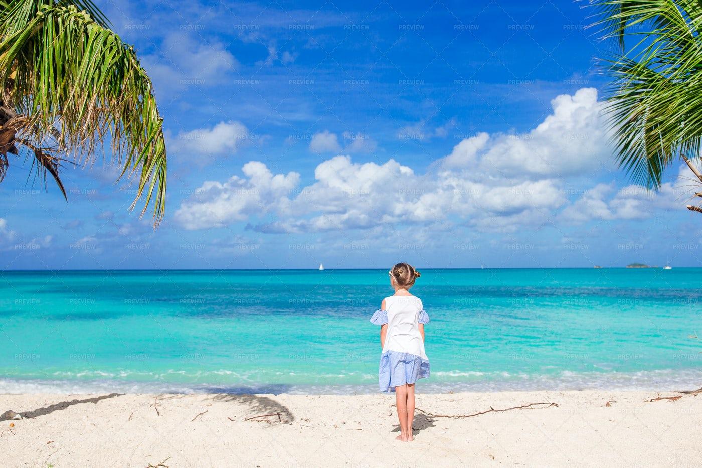 Girl Contemplating The Beach: Stock Photos