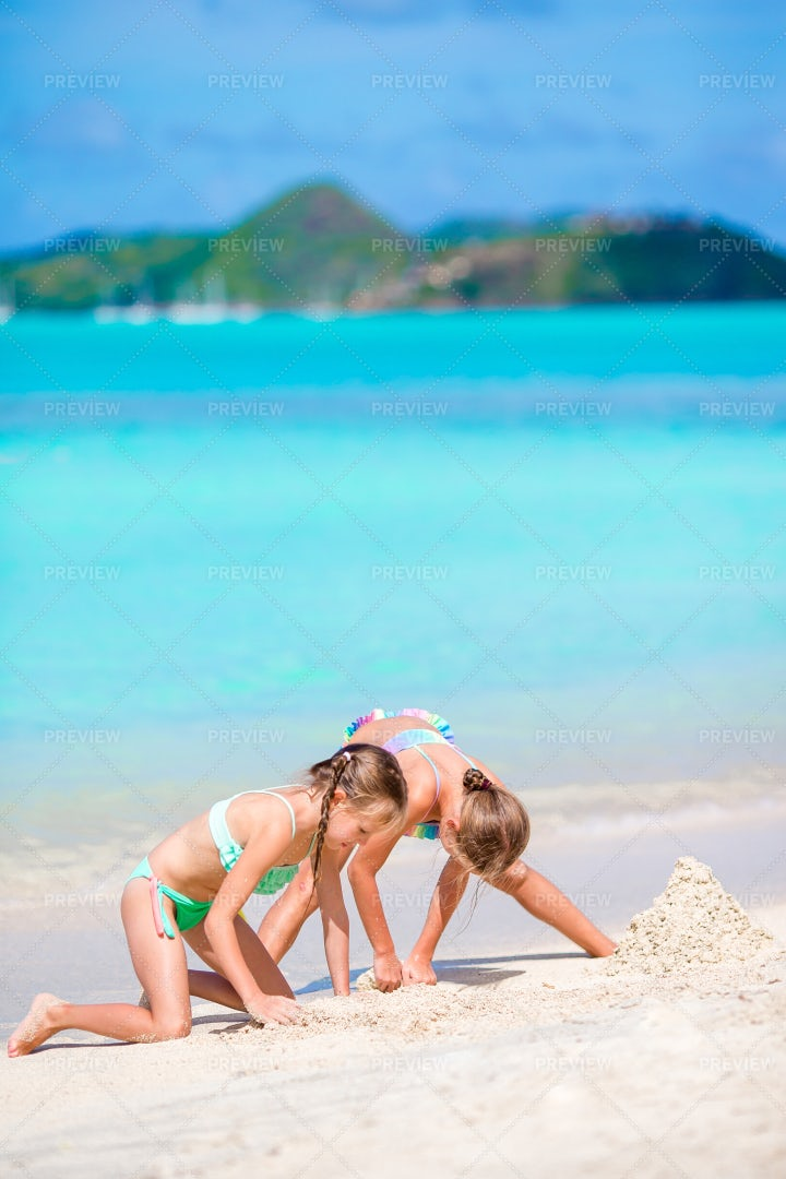 Kids Playing In Beach Sand: Stock Photos