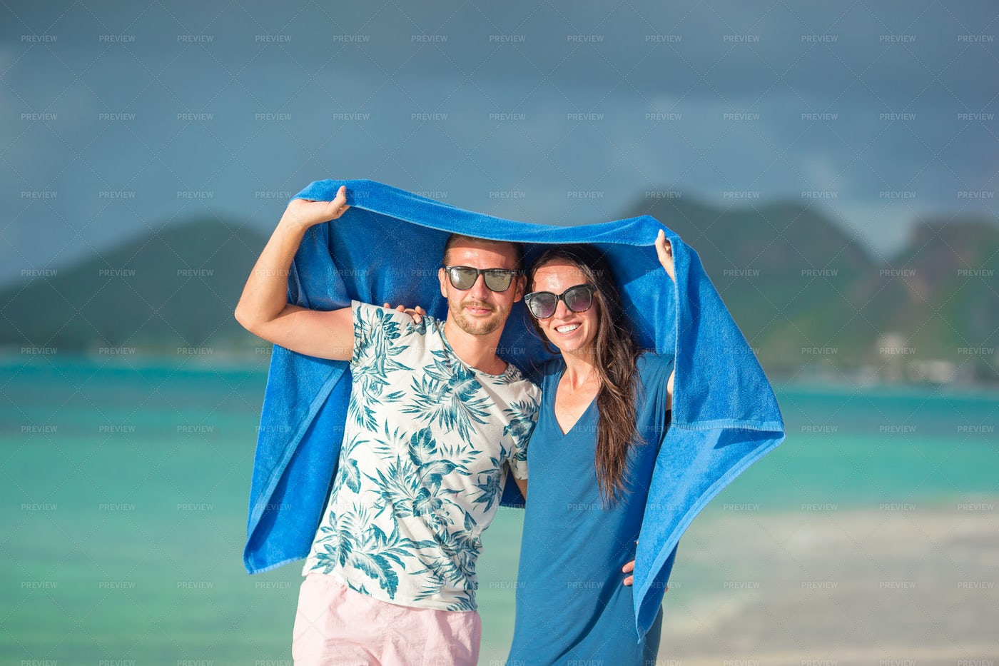 Couple Covering From The Sun: Stock Photos