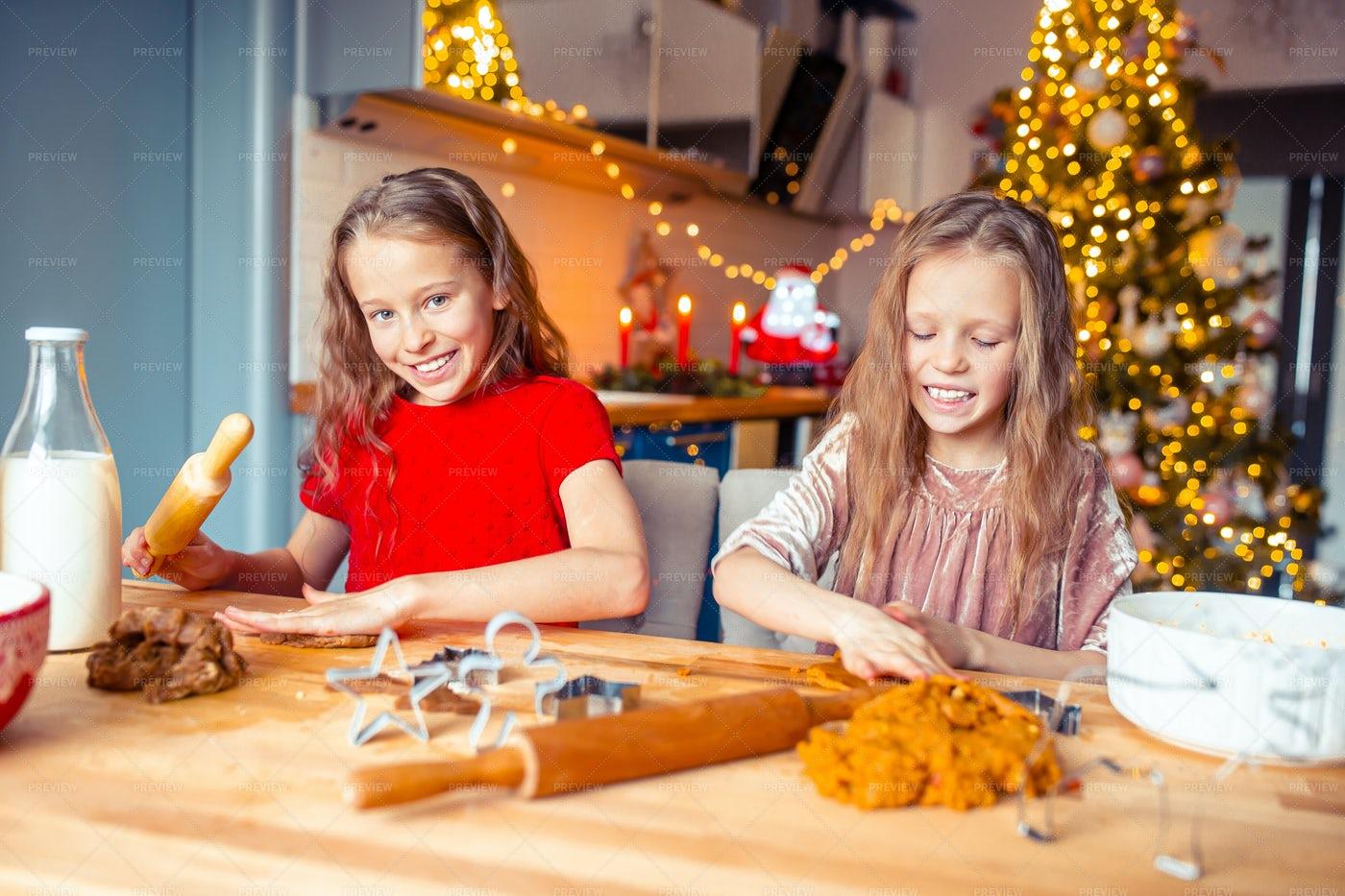 Little Girls Making Gingerbreads: Stock Photos