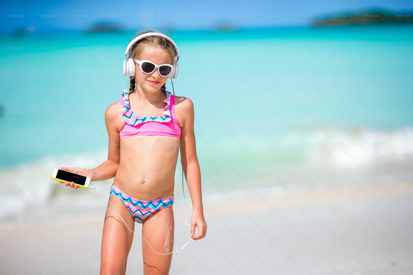 Girl Listening To Music On The Beach: Stock Photos