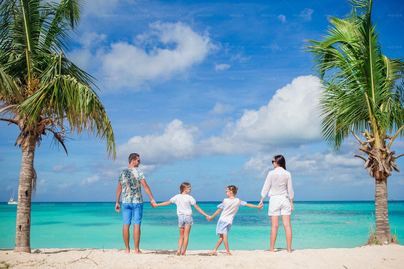 Family Holding Hand On Beach: Stock Photos