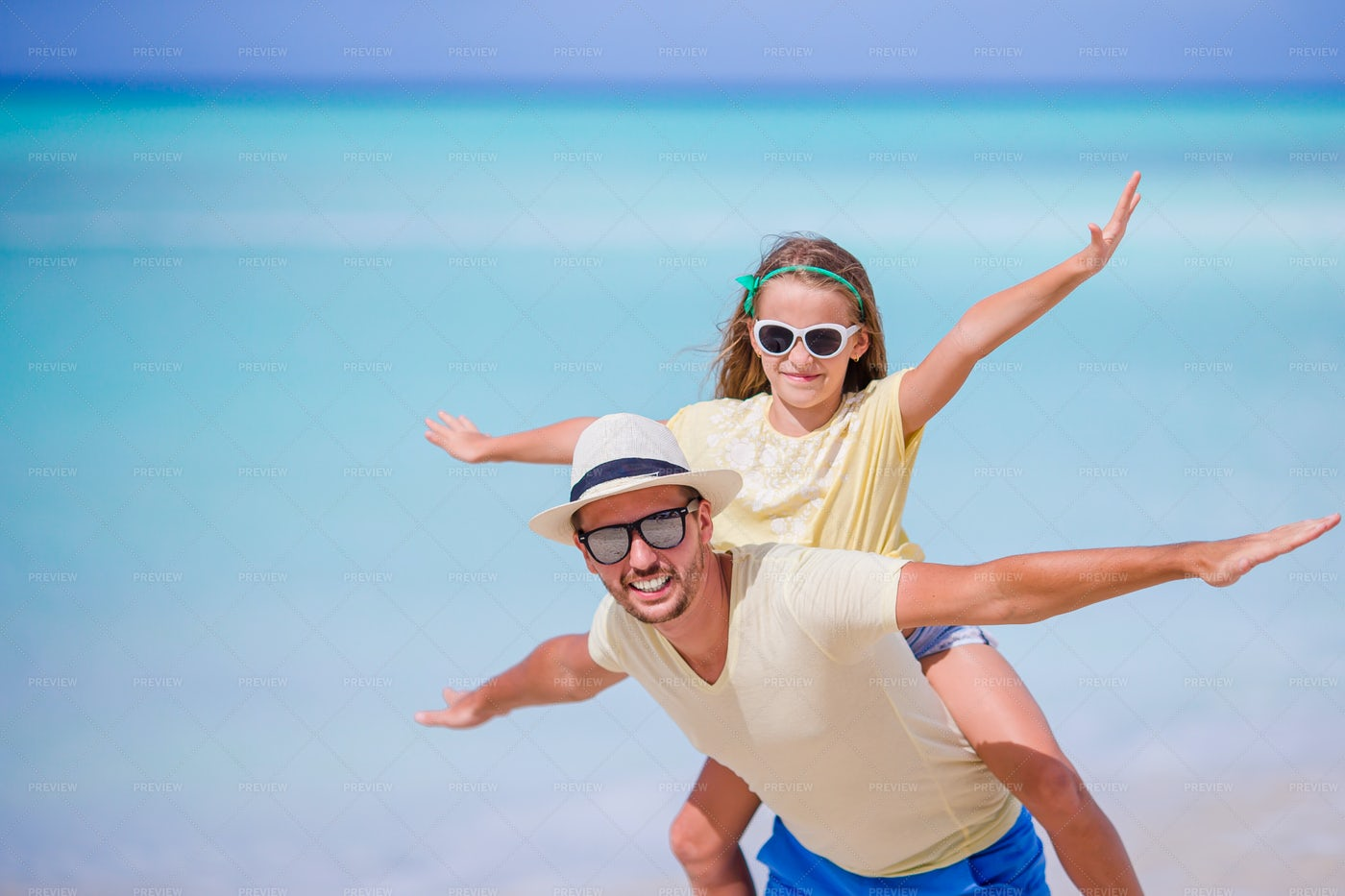 Girl On Dad's Back: Stock Photos