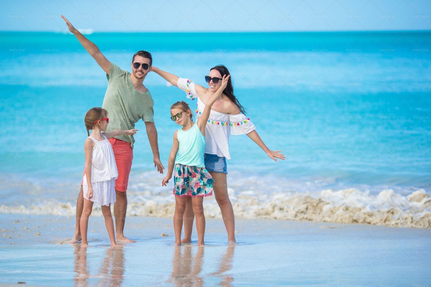 Family Plays On The Beach: Stock Photos