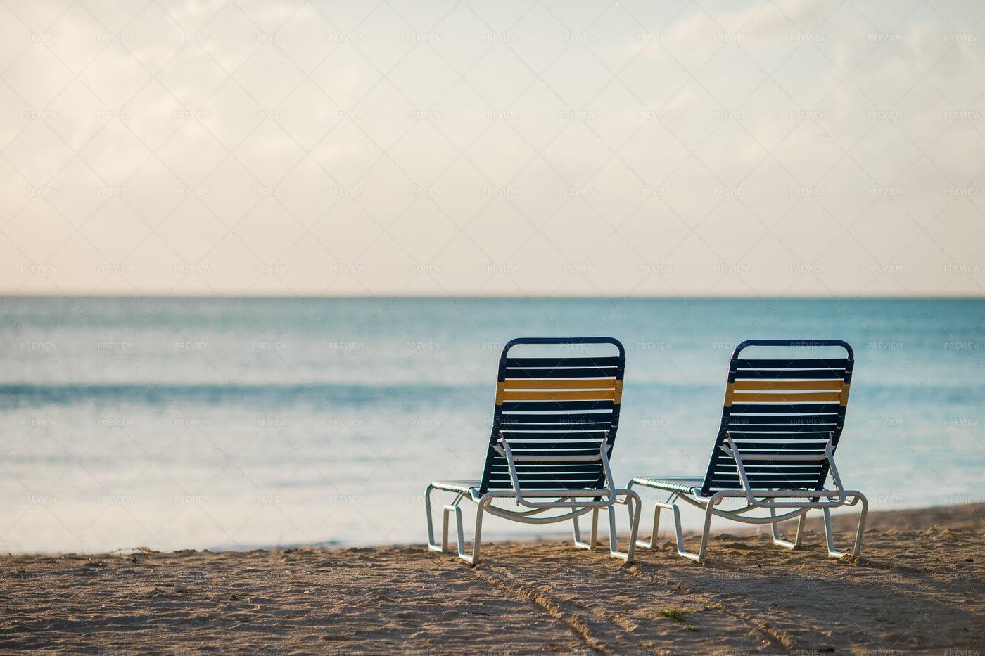 Lounge Chairs On Sandy Beach: Stock Photos
